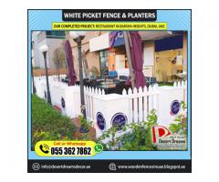 Restaurant Seating Privacy Fences | White Picket Fence and Planters | Dubai | Abu Dhabi.